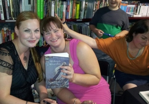 Signing at Avid, with a cheeky illustrator... Photo by Michelle Slatter.